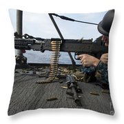 A Sailor Fires An M-240b Machine Gun Throw Pillow by Stocktrek Images