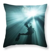 A Scuba Diver Ascends Into The Light Throw Pillow by Michael Wood