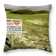 A Sign Warns Of Dangerous Unexploded Throw Pillow