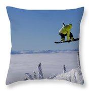 A Snowboarder Catches Air Off A Jump Throw Pillow