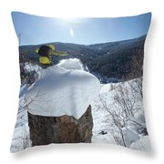 A Snowboarder Jumps Off A Cliff Throw Pillow