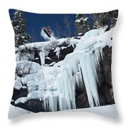 A Snowboarder Jumps Off An Ice Throw Pillow