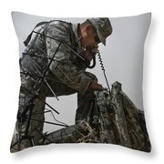 A Soldier Communicates Using A Throw Pillow