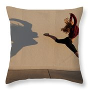 A Teenage Girl Playing With Her Shadow Throw Pillow