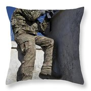 A U.s. Soldier Provides Security At An Throw Pillow