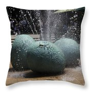 A Water Fountain With Dinosaur Eggs In The Universal Studios Singapore Throw Pillow