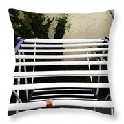 A White Plastic Stand For Hanging And Drying Clothes Throw Pillow
