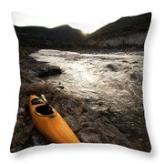 A Whitewater Kayak Rests On The Shore Throw Pillow