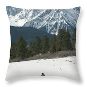 A Woman Bike Riding On The  Snow Throw Pillow