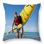 A Woman Carrying Her Sea Kayak Throw Pillow