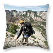 A Woman Cautiously Navigates A Steep Throw Pillow