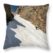A Woman Descending A Snow Slope While Throw Pillow