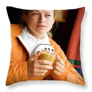 A Woman Enjoys A Warm Cup Of Cocoa Throw Pillow