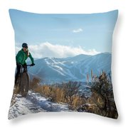 A Woman Fat Biking On The Trails Throw Pillow