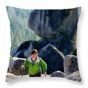 A Woman Hiking High In The Mountains Throw Pillow