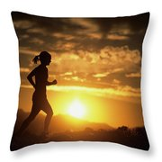 A Woman Jogs Under Sunset Throw Pillow