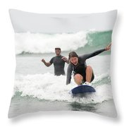 A Woman Learns To Surf Throw Pillow