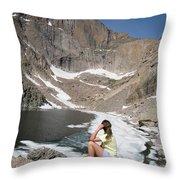 A Woman Looks Across A Partially Frozen Throw Pillow