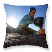 A Woman Making Coffee With Portable Throw Pillow
