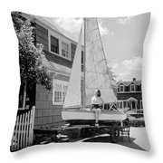 A Woman On Sailboat At Home Throw Pillow