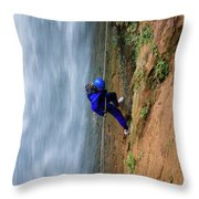 A Woman Rappelling Down Next To Deer Throw Pillow