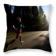 A Woman Running On A Country Road Throw Pillow