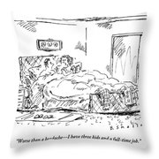 A Woman Speaks To Her Husband In Bed As She Reads By