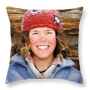 A Woman Stands Against A Log Cabin Throw Pillow
