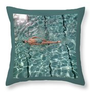 A Woman Swimming In A Pool Throw Pillow