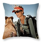 A Woman  Talks To Her Dog While Taking Throw Pillow