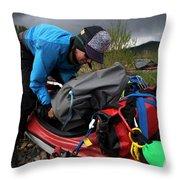 A Woman Unloads Her Kayak Throw Pillow