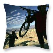 A Young Couple Carry Their Mountain Throw Pillow