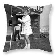 A Young Girl Hits A Golf Ball Throw Pillow