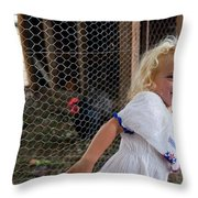 A Young Girl Shows Off Her Familys Throw Pillow