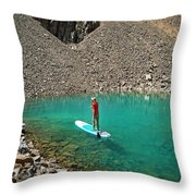 A Young Male Paddleboarding On A Small Throw Pillow