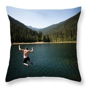 A Young Man Jumps From A Ledge Throw Pillow