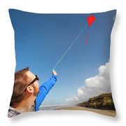A Young Man Looks Up At His Red Kite Throw Pillow