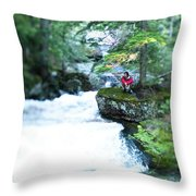 A Young Man Sits Peacefully Taking Throw Pillow
