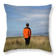 A Young Man Stands In A Field Throw Pillow