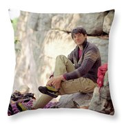A Young Rock Climber Puts On A Climbing Throw Pillow