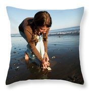 A Young Woman Collects Seashells Throw Pillow