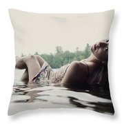 A Young Woman In A White Dress Relaxes Throw Pillow