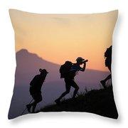 Adventure Racing Team Hiking At Sunset Throw Pillow