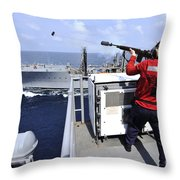 Airman Fires A Shot Line From Uss Throw Pillow