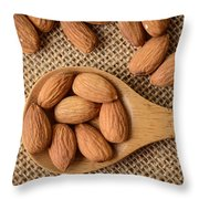 Almonds On A Spoon With Brown Background Throw Pillow