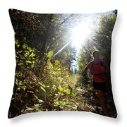 An Adult Woman Trail Running Throw Pillow