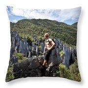 An Adventure Tourist Admires The Unique Throw Pillow
