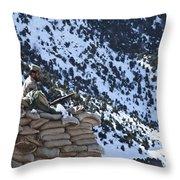 An Afghan Border Patrolman Provides Throw Pillow