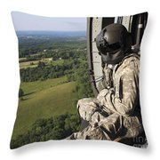 An Army Crew Chief Looks Out The Door Throw Pillow