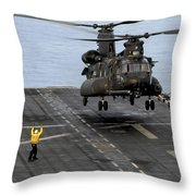 An Army Mh-47g Chinook Conducts Deck Throw Pillow